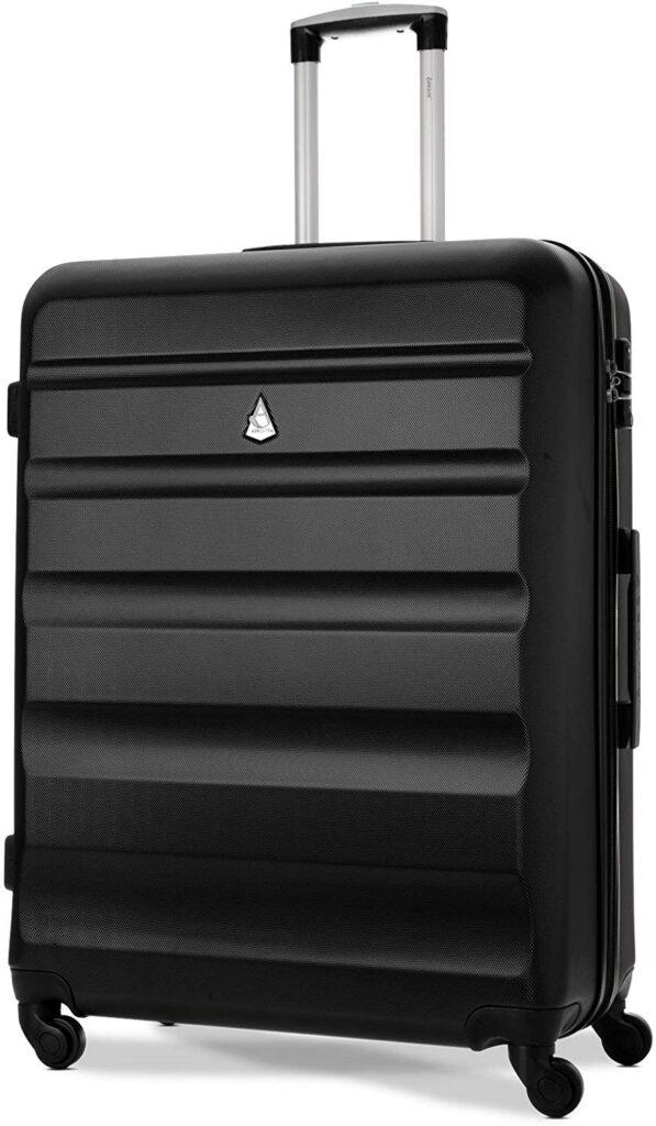 valise valises rangement bagage à main vacances en famille avion voiture train aéroport transporter affaires bagages